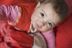 Baby girl high angle portrait on the crib Stock Images