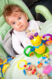 Baby girl in high chair Stock Image