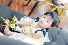 Cute baby girl hold flower at studio photo stock photos