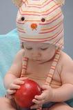 Baby girl hold organic apple Stock Photography