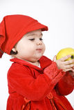 Baby girl holding an apple Stock Image