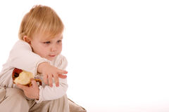 Baby girl holding apple and showing finger Royalty Free Stock Photography