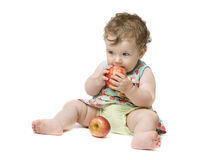 Baby girl holding big red apple Royalty Free Stock Photos