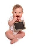 Baby girl holding blank chalkboard sign. Cutout Stock Photography