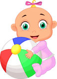 Baby girl holding colorful ball Royalty Free Stock Image