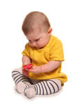 Baby girl holding a dummy. Cutout Royalty Free Stock Photos