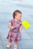 Baby girl holding flag Stock Photography