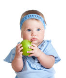 Baby girl holding green apple Royalty Free Stock Image