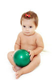 Baby girl holding green ball Stock Image