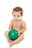 Baby girl holding green ball Stock Image
