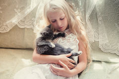 Baby girl holding hands a kitten. Pet, friend, lifestyle stock photo