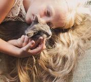 Baby girl holding hands a kitten. Pet, friend, lifestyle stock images