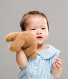 Baby girl holding her bear doll Royalty Free Stock Images