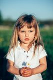 Baby girl holding little flower royalty free stock photography