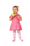 Baby girl holding a tennis ball Royalty Free Stock Photos
