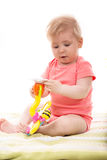 Baby girl holding toy Stock Photos