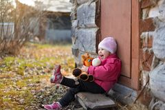 Baby girl holding toy and laughing stock photos