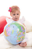 Baby girl holding world ball Royalty Free Stock Image