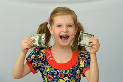 Baby girl holds in hands a torn banknote ,dollar ,banking crisis. Baby girl holds in hands a torn banknote ,dollar ,banking crisis Royalty Free Stock Photo