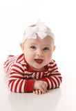 Baby girl in holiday jammies Stock Image