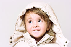 Baby girl with hood Stock Images