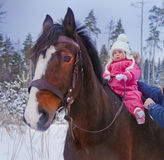 Baby girl horseback riding Stock Photos