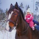 Baby girl horseback riding stock photos