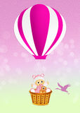 Baby girl on hot air balloon Royalty Free Stock Images