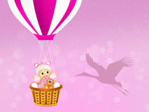 Baby girl on hot air balloon Stock Image