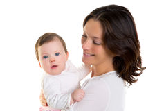 Baby girl hug in mother arms on white Stock Photos