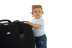 Baby girl with huge luggage. Cute baby girl with huge luggage - asking for help (isolated, with copy space stock photo