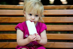 Baby girl with ice cream Royalty Free Stock Photos