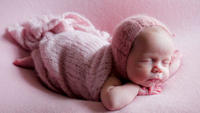 Baby girl infant in dress asleep Stock Photo