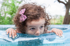 Baby girl in inflatable pool Stock Images