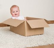 Baby girl inside a box Royalty Free Stock Images