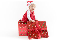 Baby Girl inside Christmas Gift Box Looking Aside royalty free stock image