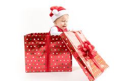 Baby Girl inside Christmas Gift Box Opens Present royalty free stock photography