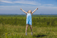 Baby girl jumping on a meadow Royalty Free Stock Photo