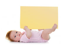Baby girl keeps a signpost blank Royalty Free Stock Photos