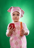 The baby girl with a kerchief and kitchen apron holding an vegetable isolated Royalty Free Stock Photo