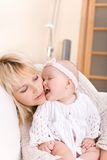 Baby girl kiss mother Stock Photography