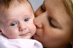 Baby girl kissed tenderly Royalty Free Stock Image