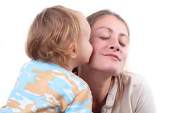 Baby girl kissing her mother Royalty Free Stock Images