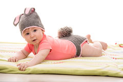 Baby girl in knitted bunny costume Royalty Free Stock Photography