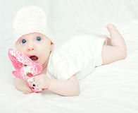 Baby Girl in Knitted Cap Stock Image