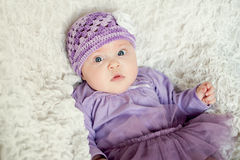 Baby girl with knitted hat with flower Royalty Free Stock Photo