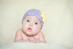 Baby girl with knitted hat with flower Stock Images
