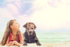 Baby girl and labrador dog Royalty Free Stock Photo