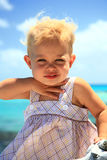 Baby girl on a lagon Royalty Free Stock Images