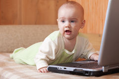 Baby girl with laptop Stock Photo